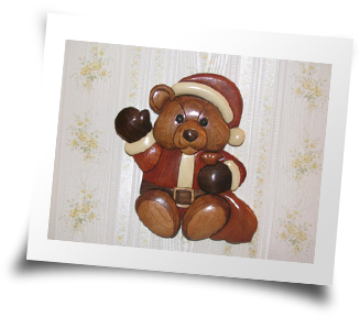 Santa bear made using the method of Intarsia by Donald Snyder