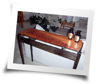 Table made out of African Mahogany and Ash by Ron Wiley